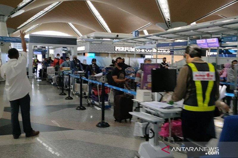 Penerbangan terakhir AOMI pulangkan 290 pekerja migran