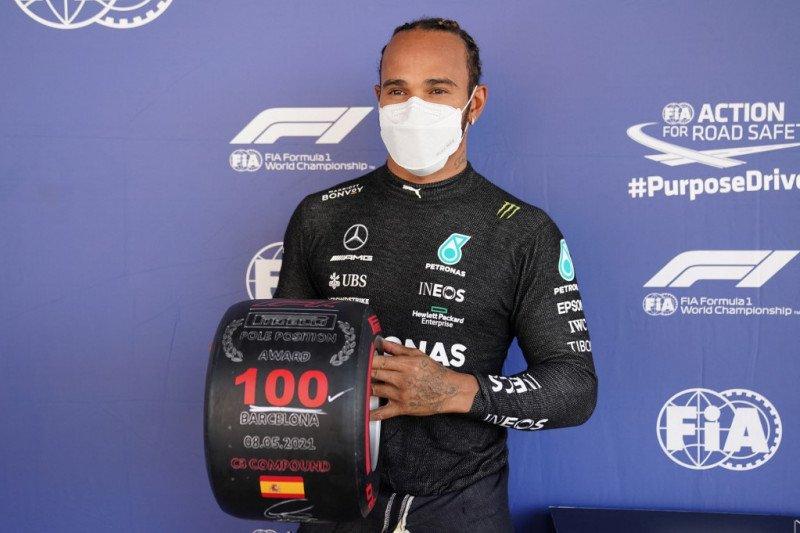 'Ini seperti yang pertama,' kata Hamilton merayakan pole ke-100