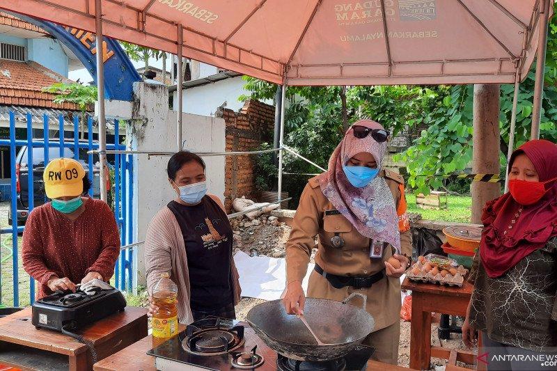13 warga RT 11/09 Kayu Putih telah kembali dari Wisma Atlet