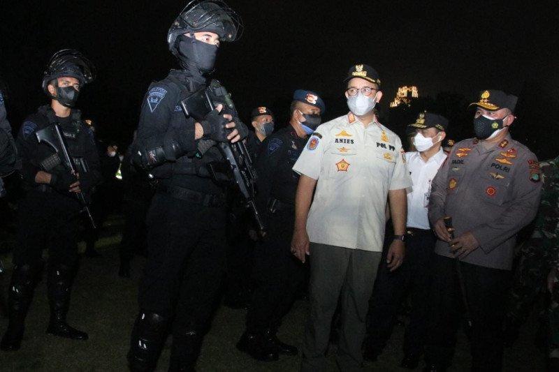 Jakarta kemarin, apel penegakan prokes hingga bantuan Satgas COVID-19