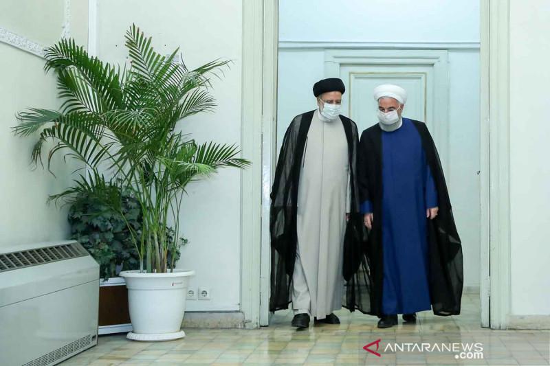 Pertemuan Presiden Rouhani dengan presiden terpilih Ebrahim Raisi