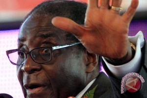 Zimbabwe`s President Mugabe calls for redoubled efforts for peaceful solutions to conflicts
