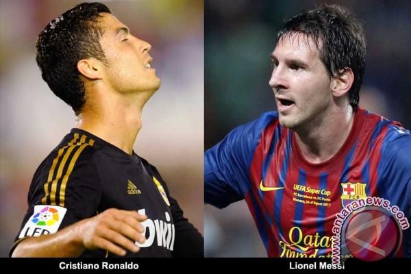 Pemain sepak bola Barcelona Lionel Messi dan pemain Real Madrid