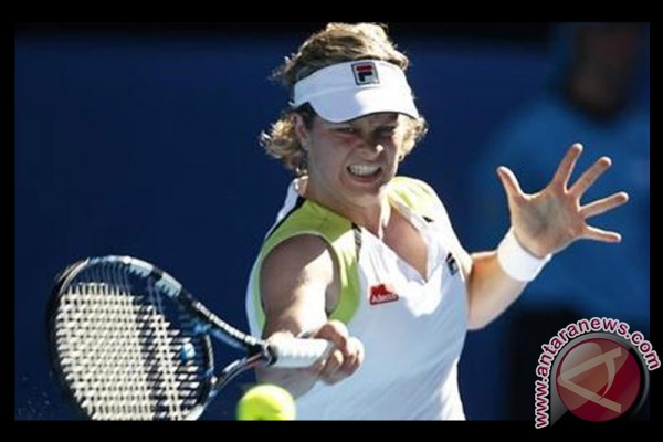 Kim Clijsters melaju ke putaran kedua