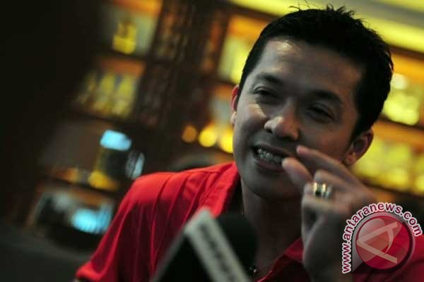 Andre Kurniawan tantang Taufik Hidayat