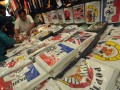 Pengunjung memilih baju kaos yang bergambar logo timnas negara yang ikut serta dalam laga sepakbola EURO 2012 di kawasan Pasar Baru, Jakarta, Sabtu (9/6). Penjualan pernak-pernik EURO 2012 berupa baju kaos timnas negara yang ikut dalam kompetisi tersebut ramai ditemukan di pasar-pasar ataupun toko-toko pakaian dengan harga jual berkisar Rp 20 ribu - Rp 100 perlembarnya. (ANTARA/Zabur Karuru)