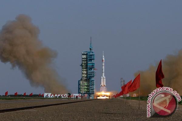 Shenzou-9 kembali ke Bumi