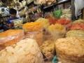 Seorang pedagang berada diantara bahan makanan yang dijual  di los salah satu Pasar Tradisional, Surabaya, Jatim, Jumat (13/7). Menurut data dari Sekretaris Jenderal Gabungan Pengusaha Makanan dan Minuman Indonesia Franky Sibarani, menjelang bulan ramadhan sejumlah pengusaha makanan dan minuman meningkatkan produksi mencapai antara 20 hingga 30 persen dengan tujuan untuk mengejar persediaan di sentra distribusi wilayah karena permintaan konsumen yang meningkat. (FOTO ANTARA/M Risyal Hidayat)