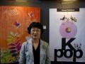 """Ketua Korea Woman Visual Designers' Association (KWVD) Hea Sok Kim berpose di depan karya seni visual desain dalam pameran """"Beauty of Korea"""" di Emti Gallery, Kediri, Jawa Timur, Selasa (17/7). Pameran seni visual karya 48 perupa perempuan Korea tersebut sebagai bentuk kerjasama pertukaran budaya dua negara. (ANTARA/Arief Priyono)"""