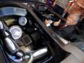 Menristek Gusti Muhammad Hatta (tengah), mencoba mobil listrik Supercar SV-1 seharga Rp. 2 miliar di salah satu stand Riset, Inovasi dan Teknologi (RITech Expo) pada peringatan Hari Kebangkitan Teknologi Nasional (Hakteknas) ke-17 bertajuk Inovasi untuk Kemandirian Bangsa di Sabuga, Bandung, Jabar, Rabu (8/8). RITech Expo yang berlangsung pada 8-11 Agustus 2012 ini menyajikan ragam hasil riset dan inovasi dari berbagai lembaga litbang kementerian/lembaga, litbang pemerintah daerah, litbang universitas, penggiat iptek Indonesia yang terdiri dari 77 institusi dalam 140 both guna meningkatkan kontribusi iptek untuk kesejahteraan rakyat, meningkatkan daya saing produk industri dan kemandirian bangsa. (FOTO ANTARA/Fahrul Jayadiputra)