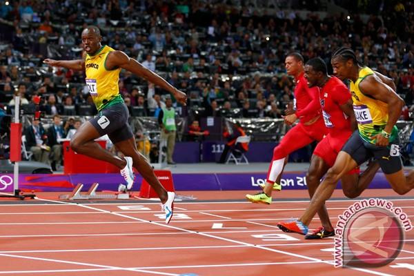 Bolt pertahankan gelar 100m putra
