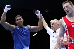 Juara Olimpiade Joshua akan bertarung untuk gelar IBF