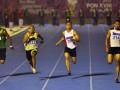 Pelari NTB Iswandi (kedua kanan) memimpin pada nomor Final Lari 100 meter Putra PON XVIII 2012 di Stadion Atletik Rumbai, Pekanbaru, Riau, Rabu (14/9). Iswandi berhasil meraih emas dengan catatan waktu 10,41 detik. (FOTO ANTARA/Yudhi Mahatma)