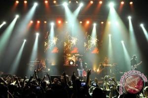 Guns N' Roses punya lagu untuk tiga album