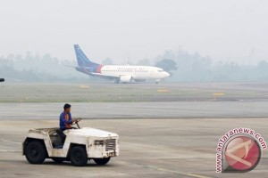 Haze of smokes from bush fires disrupts flight schedules in Batam