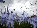 Sejumlah perwira remaja TNI AL meluapkan kegembiraan dengan melempar topi ke udara usai upacara Prasetya Perwira (Praspa) TNI-POLRI 2013 di Lapangan Banda, Akademi Angkatan Laut (AAL) Bumi Moro Surabaya, Jatim, Selasa (2/7). Sebanyak 736 Taruna Akademi TNI dan Polri yang terdiri dari 238 Taruna Akmil, 105 Kadet AAL, 108 Karbol AAU dan 285 Taruna Polri , 256 Taruna/ 49 Taruni Polri dilantik menjadi Perwira TNI � Polri oleh Presiden Susilo Bambang Yudhoyono. (ANTARA FOTO/M Risyal Hidayat)