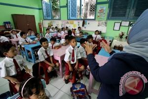 Tidak ada lagi tinggal kelas di SD