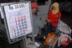 Tuna Rungu Penjual Kalender