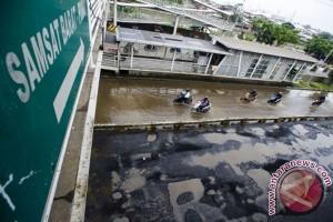 Jalan Rusak Akibat Banjir