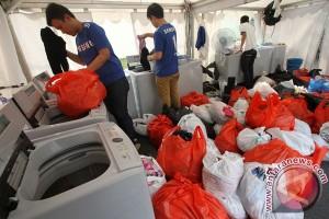 Cuci Baju Pengungsi Banjir
