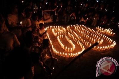 """Kampanye """"Earth Hour"""" berlangsung di tengah hujan"""
