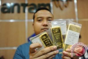 Pelemahan dolar AS dorong harga emas naik tipis