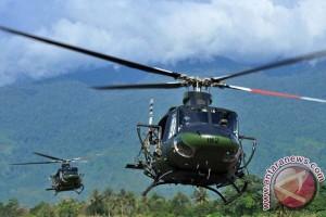 HELI JATUH - Mereka sedang membantu polisi di Poso