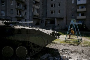 Ukraina dan pemberontak tarik pasukan dari kota timur