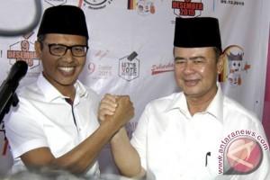 Hitung cepat LSI nyatakan pasangan Irwan-Nasrul menang