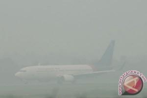 BENCANA ASAP - 56 penerbangan batal akibat asap