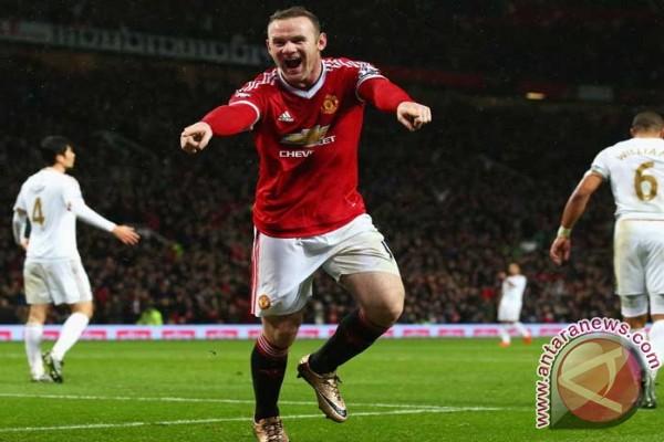 Bantah pindah ke China, Rooney mengaku masih betah di MU
