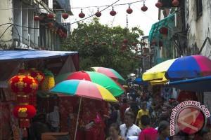 Hujan deras warnai perayaan Imlek di Banjarmasin