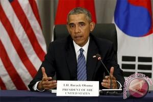 Obama dan dunia bela perdagangan bebas, Trump beda sendiri