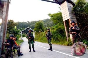 Jenazah diduga Santoso sedang dievakuasi dari hutan