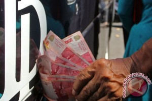 Rupiah melemah menjadi Rp13.465 per dolar AS