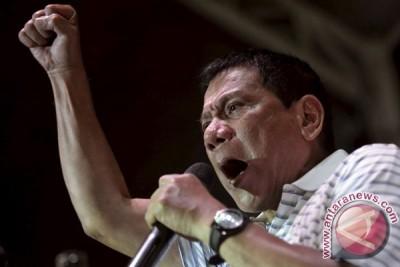 Tak mau membeo, Duterte akan minta Obama dengar dulu versi HAM dia