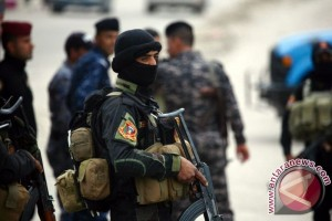 10 security members killed in is suicide attacks in Iraq