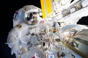 U.S. astronauts perform seven-hour spacewalk outside station