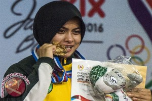 Inadrah clinches her first gold in wrestling