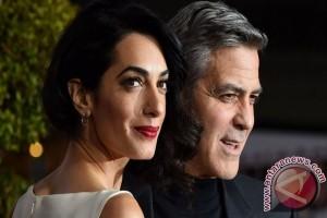 Istri hamil, George Clooney janji stop pergi ke daerah konflik