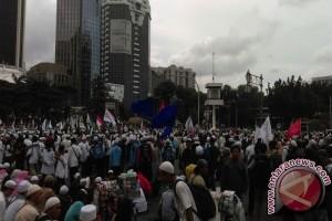 Massa 313 penuhi Jalan Medan Merdeka Selatan