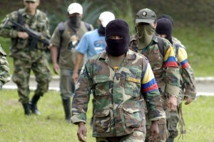 Colombia`s FARC rebels give up guns in disarmament camps