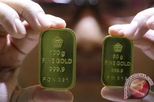 Emas naik tipis setelah dolar AS melemah