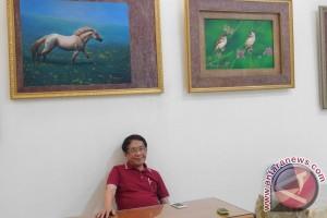 "Pelukis kaleng Khong Ghuan ungkapkan ""uneg-uneg"" di balik lukisannya (video)"