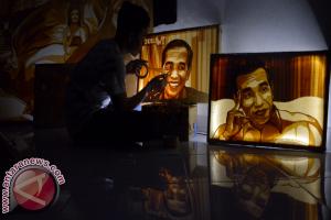 Seniman Dede Rai rampungkan lukisan Jokowi