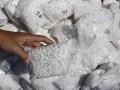 Petugas menunjukkan barang bukti berupa ratusan ribu pil koplo sebelum dimusnahkan di Kantor Kejaksaan Negeri Malang, Jawa Timur, Senin (17/7/2017). Pemusnahan barang bukti narkotika tersebut merupakan hasil dari 318 perkara sejak Juli 2016 dengan rincian ganja sebanyak 14 kg, sabu-sabu 684 gram dan pil koplo sebanyak 184.545 butir. (ANTARA/Ari Bowo Sucipto)
