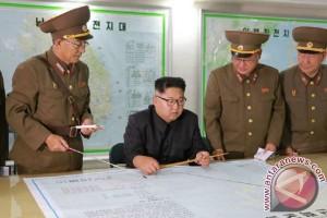 Beginilah suasana rapat perang dipimpin Kim Jong-un