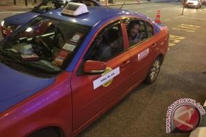 Kala Menpora keliling Kuala Lumpur dengan taksi